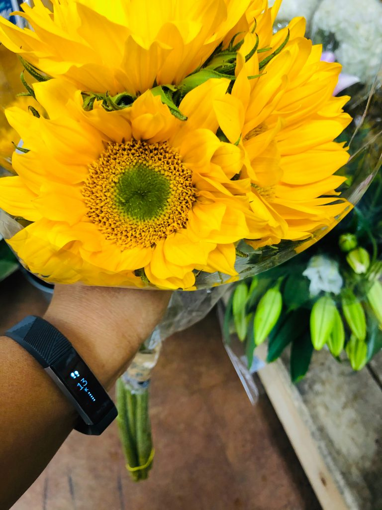 Sunflowers and the Fitbit Alta HR.
