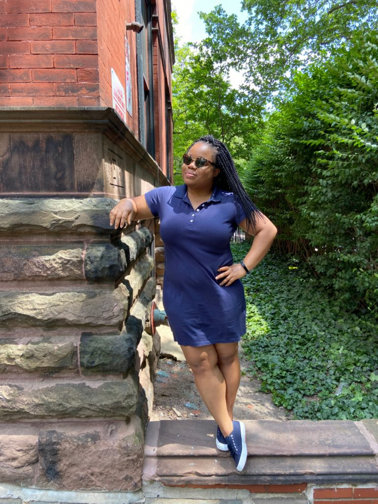 Navy polo dress with navy Superga sneakers.
